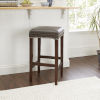 This item: Brown Upholstered Saddle Stool