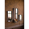 This item: Set of Three Tall Metal Framed Mirrors With Shelves
