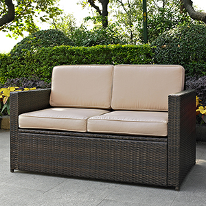 Palm Harbor Outdoor Wicker Loveseat in Brown With Sand Cushions