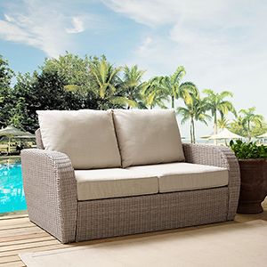 St Augustine Outdoor Wicker Loveseat in Weathered White  With Universal Oatmeal Cushion