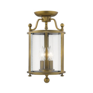 Wyndham Heirloom Brass 8-Inch Three-Light Semi Flush Mount With Transparent Glass