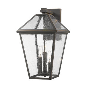 Talbot Rubbed Bronze Three-Light Outdoor Wall Sconce with Seedy Glass