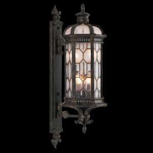 Devonshire Four-Light Outdoor Wall Mount in Antiqued Bronze Finish with Textured Seedy Glass Panes