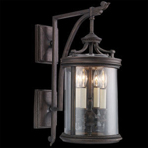 Louvre Four-Light Outdoor Wall Mount in Bronze Finish with Features Clear Hand Blown Glass and Antiqued Candles