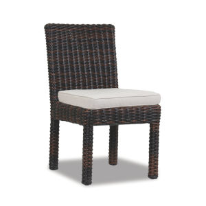 Montecito Cognac Wicker Armless Dining Chair with Cushion in Canvas Flax with Self Welt