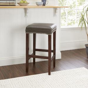 Brown Upholstered Saddle Stool