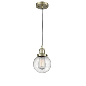 Beacon Antique Brass One-Light Mini Pendant with Seedy Glass