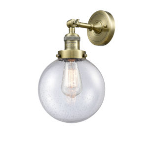 Large Beacon Antique Brass One-Light Wall Sconce with Seedy Glass