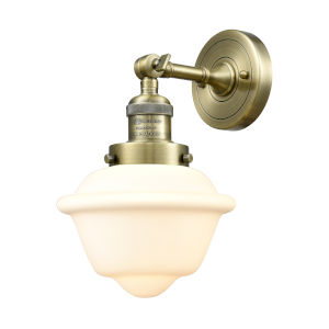 Small Oxford Antique Brass LED Wall Sconce with Matte White Cased Glass