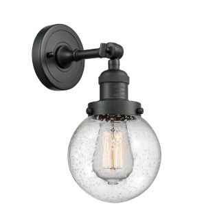 Beacon Matte Black LED Wall Sconce with Seedy Glass