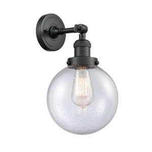 Large Beacon Matte Black One-Light Wall Sconce with Seedy Glass