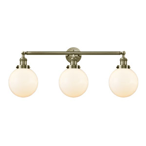 Beacon Antique Brass Three-Light LED Bath Vanity with Eight-Inch Matte White Cased Globe Glass