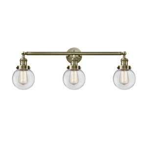 Beacon Antique Brass Three-Light Bath Vanity with Six-Inch Clear Globe Glass