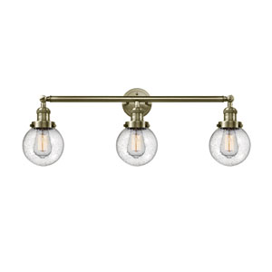Beacon Antique Brass Three-Light LED Bath Vanity with Six-Inch Seedy Globe Glass