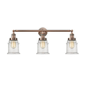Canton Antique Copper Three-Light Bath Vanity with Seedy Glass