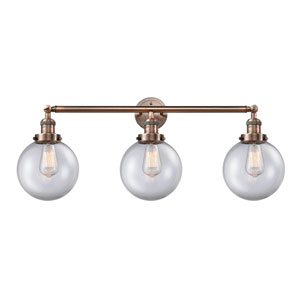 Beacon Antique Copper Three-Light Bath Vanity with Eight-Inch Clear Globe Glass