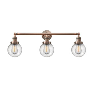Beacon Antique Copper Three-Light Bath Vanity with Six-Inch Seedy Globe Glass