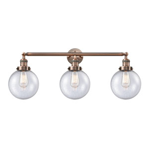 Beacon Antique Copper Three-Light LED Bath Vanity with Eight-Inch Seedy Globe Glass