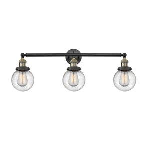 Beacon Black Antique Brass Three-Light Bath Vanity with Six-Inch Seedy Globe Glass