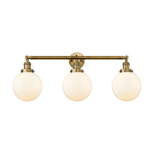 Beacon Brushed Brass Three-Light Bath Vanity with Eight-Inch Matte White Cased Globe Glass