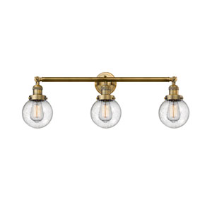 Beacon Brushed Brass Three-Light Bath Vanity with Six-Inch Seedy Globe Glass