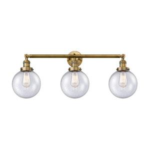 Beacon Brushed Brass Three-Light LED Bath Vanity with Eight-Inch Seedy Globe Glass