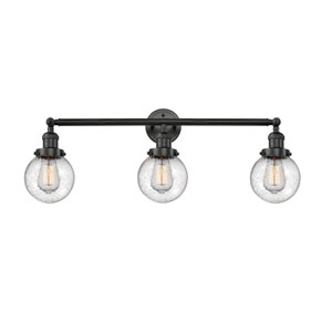 Beacon Matte Black Three-Light LED Bath Vanity with Six-Inch Seedy Globe Glass