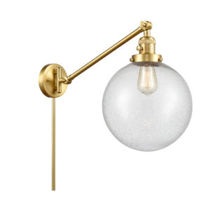 Franklin Restoration Satin Gold 10-Inch One-Light Swing Arm Wall Sconce with Seedy Glass Shade