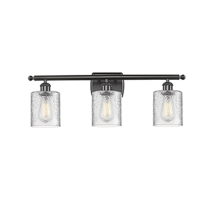 Cobbleskill Oiled Rubbed Bronze Three-Light Bath Vanity with Clear Ripple Drum Glass