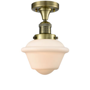 Small Oxford Antique Brass One-Light Semi Flush Mount with Matte White Cased Glass