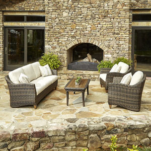 Outdoor Sycamore 4-Piece Brown Wicker Set with Climaplush™ Cushions and Tan Arm Pillows