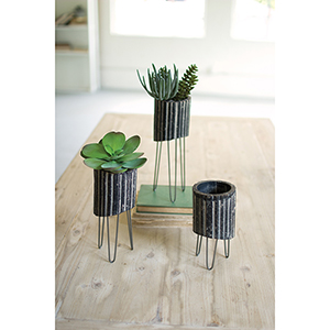 Set of Three Black And White Clay Cylinders On Wire Bases