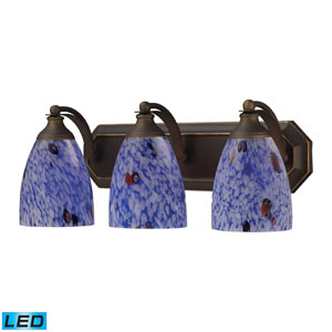 Vanity Three Light LED Bath Fixture In Aged Bronze And Starburst Blue Glass