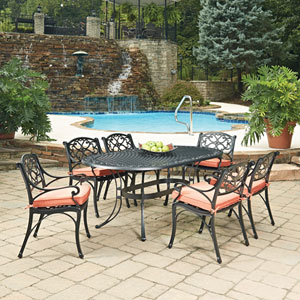 Biscayne Black Oval 7 Piece Outdoor Dining Table and 6 Arm Chairs with Cushions