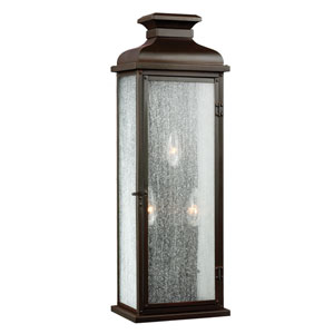 Pediment Dark Aged Copper Three-Light 7-Inch Wide Outdoor Wall Sconce with Clear Seeded Glass