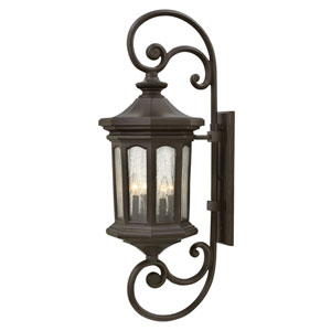 Raley Oil Rubbed Bronze 13-Inch Four-Light Outdoor Extra Large Wall Mount