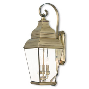 Exeter Antique Brass 10-Inch Three-Light Outdoor Wall Lantern with Clear Beveled Glass