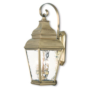 Exeter Antique Brass 10-Inch Three-Light Outdoor Wall Lantern with Clear Water Glass