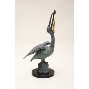 Pelican Eating Fish Statue