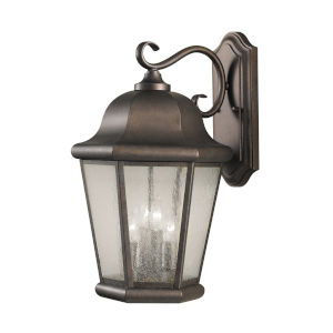 Martinsville Corinthian Bronze Four-Light Outdoor Wall Sconce with Clear Seeded Shade