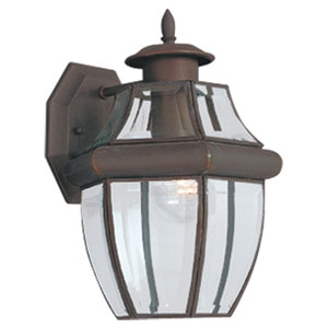 Curved Beveled Bronze One-Light Outdoor Wall Mount