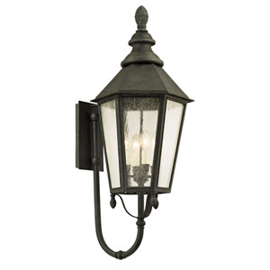 Savannah Vintage Iron Four-Light Outdoor Wall Sconce with Clear Seeded Glass
