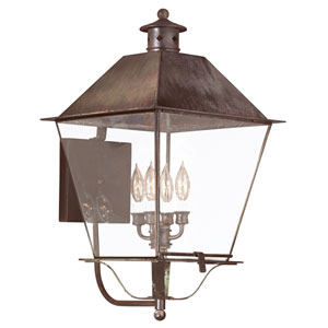 Montgomery Natural Rust Four-Light Metal Top Lantern Wall Mount with Clear Seeded Glass