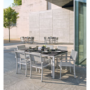 Travira - 7-Piece Dining Set with 63x40 Table and Sling Chairs - Powder Coated Aluminum - Lite-Core Charcoal - Titanium Sling