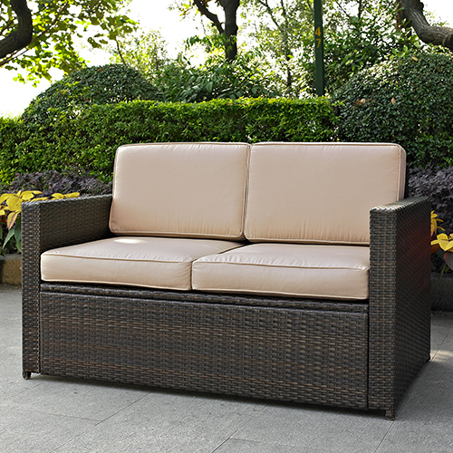 Crosley Furniture Palm Harbor Outdoor Wicker Loveseat in Brown With Sand Cushions