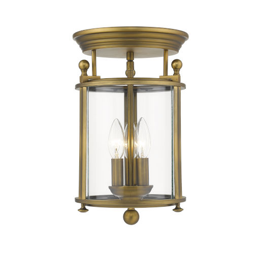 Wyndham Heirloom Brass Three-Light Flush Mount With Transparent Glass