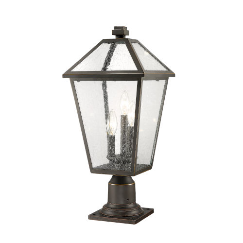 Talbot Rubbed Bronze Three-Light Outdoor Pier Mounted Fixture with Seedy Glass