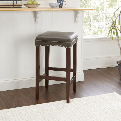 Brown Upholstered Saddle Stool