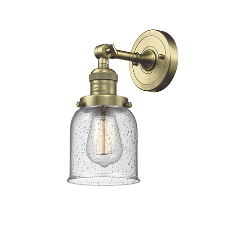 Innovations Lighting Small Bell Antique Brass One-Light Wall Sconce with Seedy Bell Glass