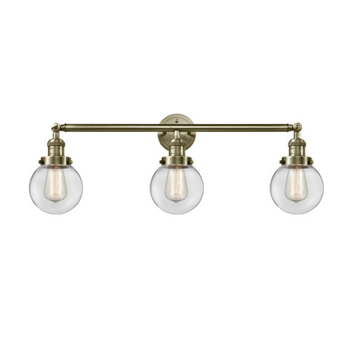 Innovations Lighting Beacon Antique Brass Three-Light LED Bath Vanity with Six-Inch Clear Globe Glass